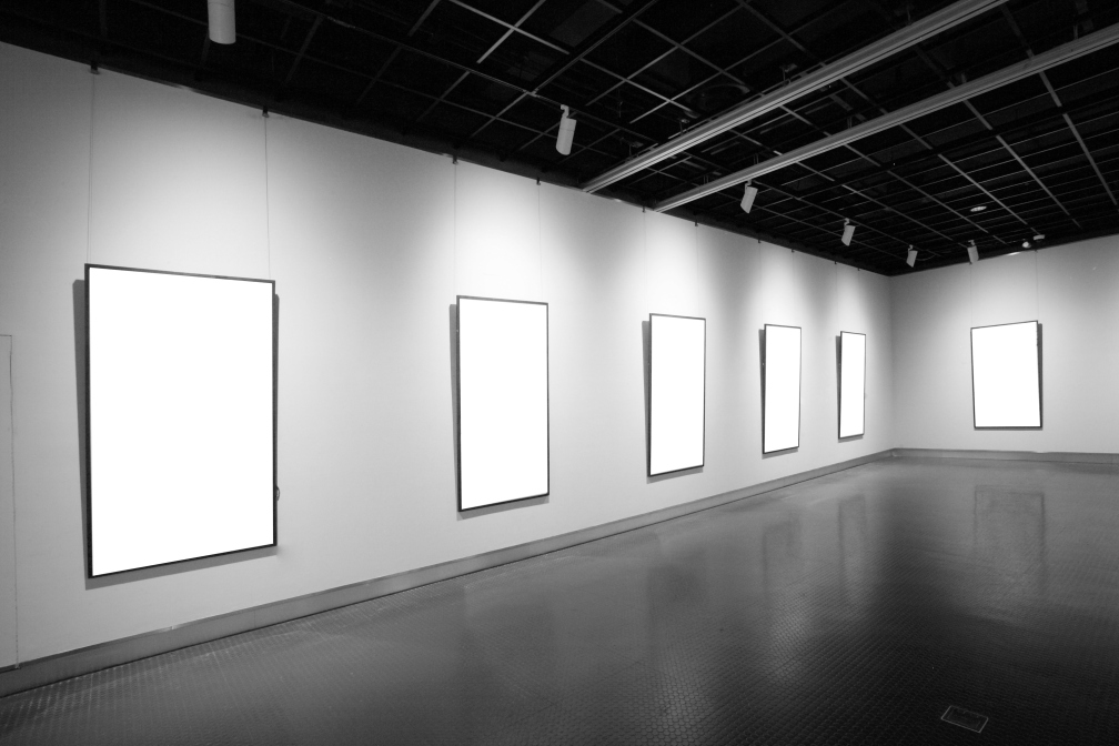 Photo of blank frames on wall in Art Gallery